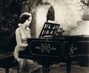 greta-garbo-playing-a-piano-in-torrent-1926-cropped